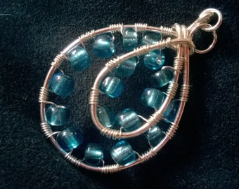 Blue bead and wire wrapped teardrop pendant
