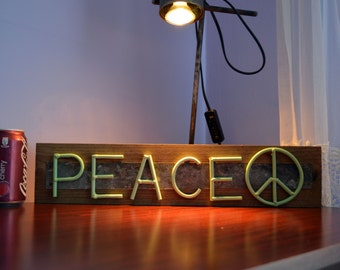 Rustic pallet plank and welded mint peace sign.