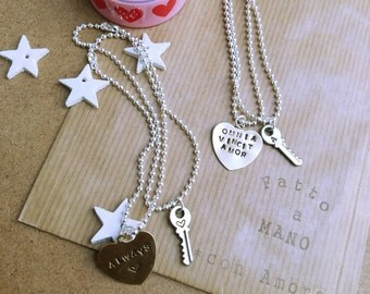 Pair of bracelets with heart and engraved key