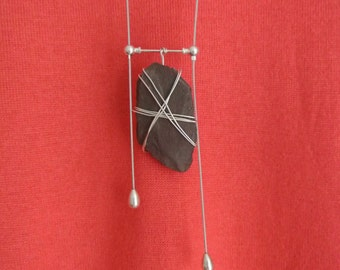 Silver wire wrapped slate on an interchangeable necklace