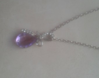 Silver necklace with purple crystal