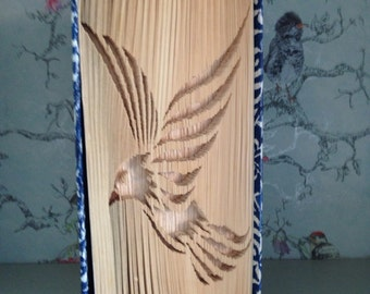 Folded book art bird in flight