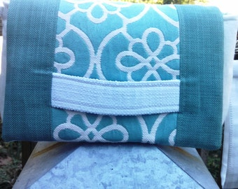 This dusty sage/aqua and white clutch is stunning!  A white linen handstrap adds contrast; makes carrying easy. A wrist strap for hands free