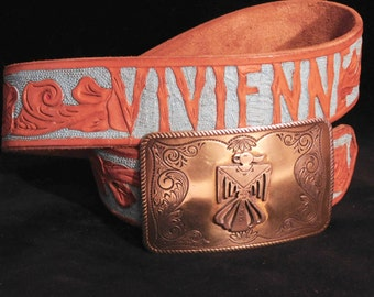 Hand tooled leather belt-- turquoise and tan-- Thunderbird buckle