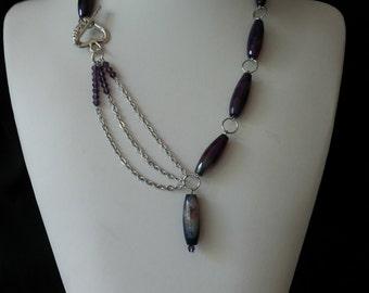 Asymmetrical necklace.