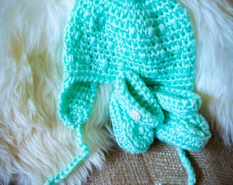 Handmade Crocheted hat and matching booties for a baby boy or girl.