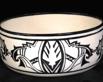 Bold tribal design ceramic bowl, signed by artist