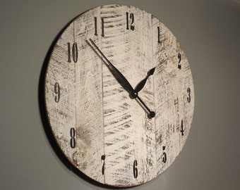 """24"""" Rustic wall clock. Made from rough cut lumber that is distressed and finished to give it that barn wood / reclaimed lumber look."""