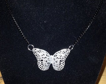 Silver lace butterfly on chain.
