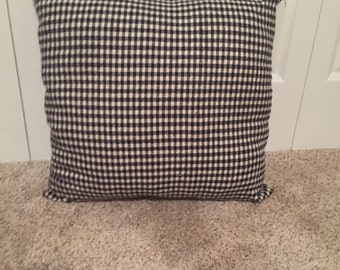 Black and White checkered decorative pillow.
