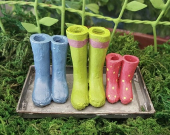 Miniature Colorful Rain Boots on a Metal Tray