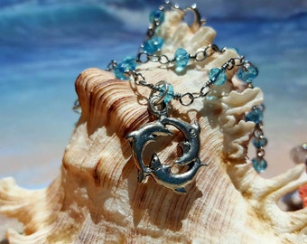 Circle of Dolphins Anklet on azure blue crystal wire-wrapped bead chain.