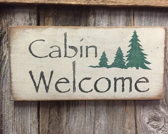 Handmade rustic cabin welcome sign