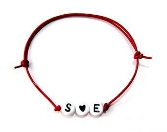 Red name bracelet, letters & Black heart