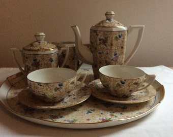 Floral , delicate and pretty coffee set.