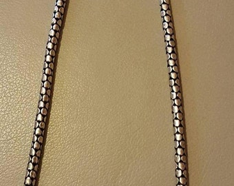Solid sterling silver thick chain with a hand designed pattern.