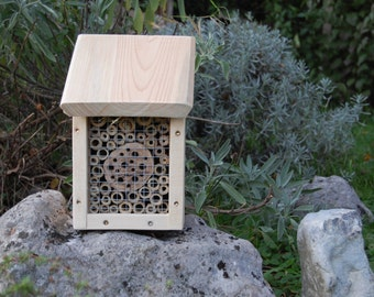 Nestbox for solitary bees, or insect hotel, or bug hotel - wildlife habitat with bamboo filling for wild bees