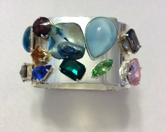 Silver bracelet spring opening with beautiful rhinestone rainbow and multiform