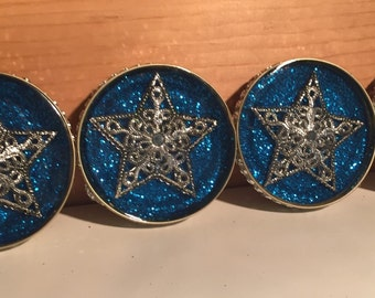 Set of four silver star coasters