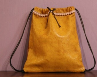 Leather backpack. Handbag. Leather. Pelle.