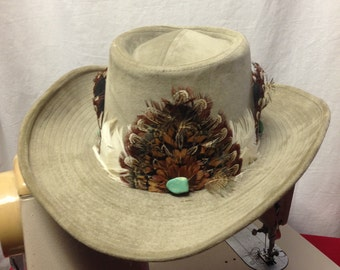 1970s Men's Cowboy Hat in SZ 6-3/4.  It is cotton and rayon, pale grey with gorgeous feathers, turquoise nuggets. 1 of a kind.