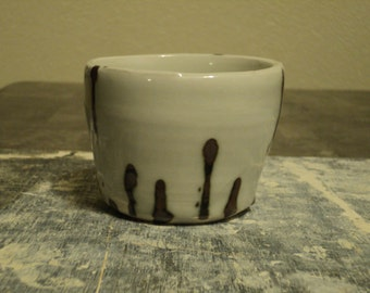 White and Rust Porcelain Cup