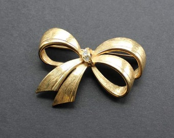 Avon Signed Ribbon Bow Brooch Vintage Pin Brushed Gold Tone Clear Rhinestones