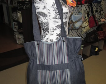 bag has hand in jeans 2 material one striped and a bag United Tote everything doubled with pouch