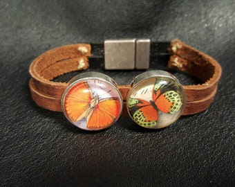Brown and black leather cuff bracelet with orange butterflies