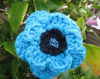 Hand crocheted layered flower brooch in turquoise and black