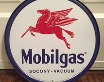 Reproduction Mobilgas round collectible metal sign