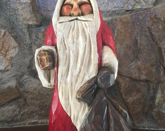 Whimsical folk art sculpture of Santa or Father Time