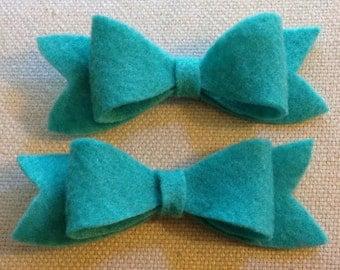 Adorable handmade turquoise felt bow clips!