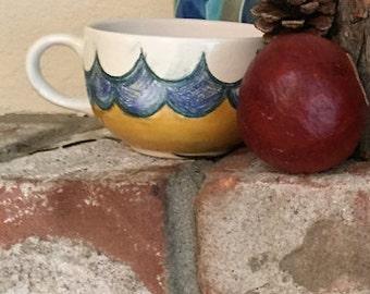 Teacup hand embellished