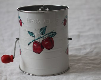 Bromwell's Tin 3 Cup White Apple Measuring Flour Sifter with Red Hand Crank