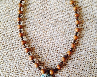 Wooden Beaded Necklace with Blue Flowered Pendant