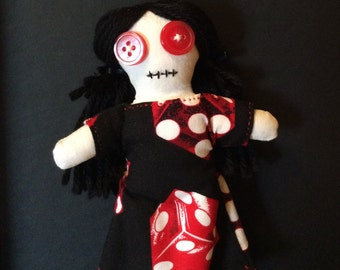 button eyes doll