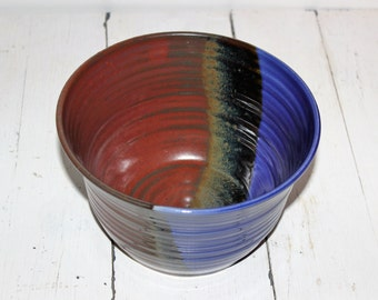 blue and red ceramic serving bowl