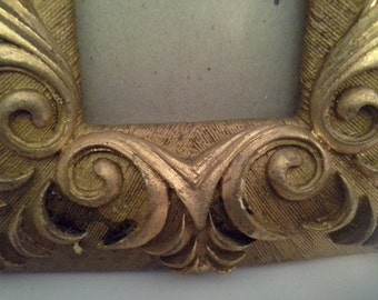 Sold Ornate gold frame, with glass