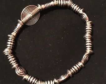 Silver beaded bracelet, unique design with stretch band