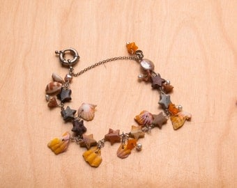Sunrise Shells and Onyx Star Bracelet