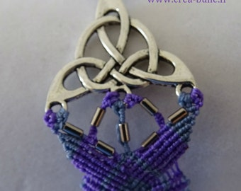 Bracelet woven around a Celtic print in shades of purple and blue