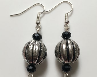 Silver beads with black accents