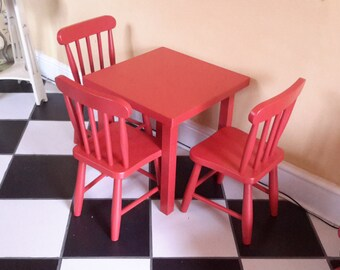 Painted red table and 3 chair set.