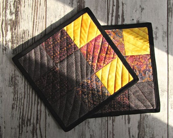 "Set of two hot pads patchwork from the series ""Autumn tundra-2""."