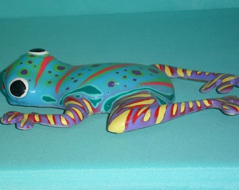 Lovely multicolored frog in fiber glass. Handmade painting. Gives cheerfulness in your home