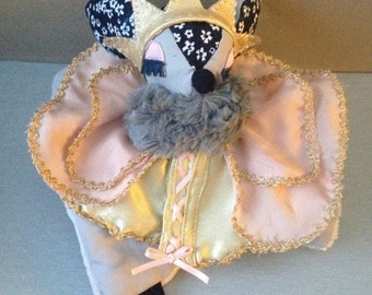 disguise with her dress and Crown Princess doudou