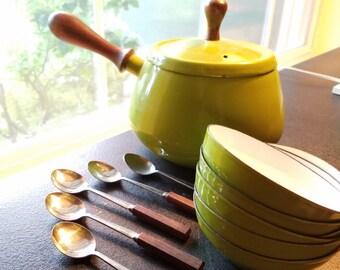Avocado green enamel fondue set with teak topped lid and handled pot, 6 matching enamel ramekins and 5 teak and silver spoons, Styson, Japan