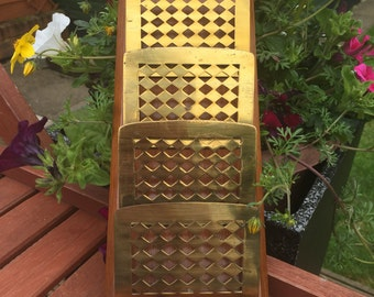A Vintage wall mounted solid wood and brass letter/paper holder