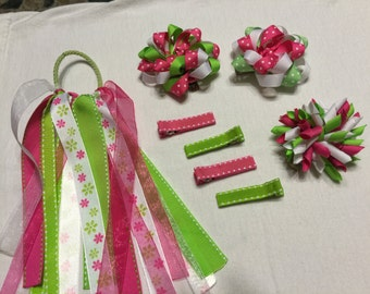 Beautiful hand made bows in a variety of pink, green and white colors